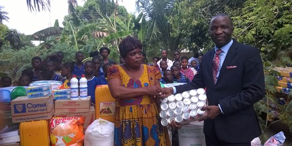 Founder of the orphanage Emma Boafo is receiving goods from a company operating in the community
